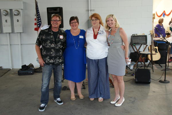 Greg Ridge, Caroline McNabb, Amber Davidson and Liz McNabb, left to right, the four newly elected leaders of the Costa Mesa Democratic Club, pose for a photo during the club's kickoff party Tuesday night.