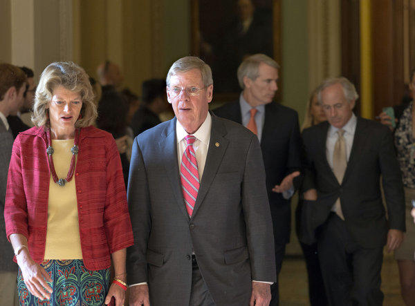 Sen. Lisa Murkowski (R-Alaska) and other senators walk to a closed-door meeting July 15 in the Old Senate Chamber to discuss a showdown over presidential nominees and filibuster rules.