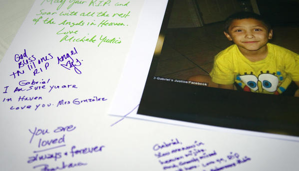 Tributes are written on a poster board during a memorial service for 8-year-old Gabriel Fernandez at Church of the Foothills in Sylmar.