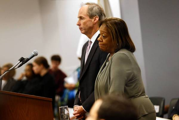 Chicago Public Schools executives Tim Cawley and Barbara Byrd-Bennett pause as they are interrupted by audience members while discussing the new school budget last week.