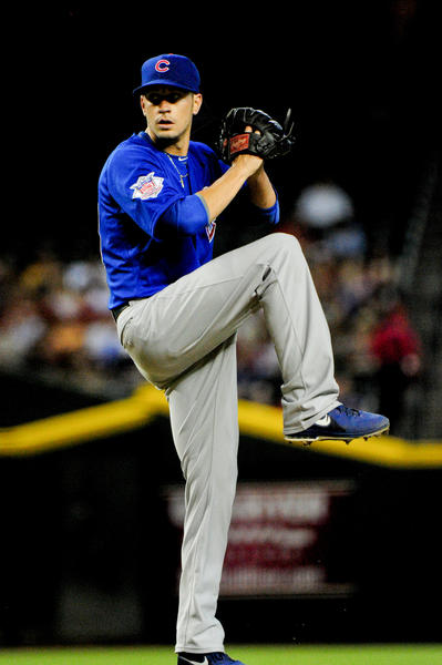 Cubs starting pitcher Chris Rusin throws during the first inning against the Diamondbacks at Chase Field.