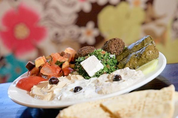 Pita Jungle's Mediterranean Platter comes with hummus, baba galosh, ratatouille, tzatziki, taboule, feta cheese, dolmades, falafel, green beans and pita bread.