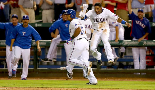 Adrian Beltre runs the bases while Elvis Andrus, right, celebrates his walk-off home run, the Texas Rangers' third consecutive victory over the Angels by home run.
