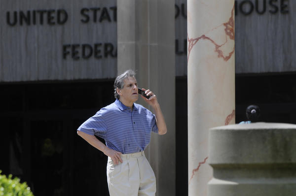 Bridgeport personal injury lawyer, Joseph P. Haddad, talks on his cell phone outside the Bridgeport Federal Court building Wednesday.
