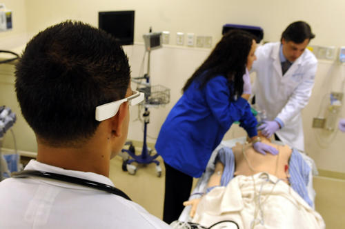 Doctor Paul Bajwa, left, a resident at Hartford Hospital, uses Google Glass during a mock medical emergency at the hospital to instruct registered nurse, Dawn Filippa, and Doctor Thomas Nowicki on how to deal with the medical dummy they are using as a patient. Nowicki is director of Cognitive Simulation at the hospital's Center for Education Simulation and Innovation, CESI, and the director of the residency program.