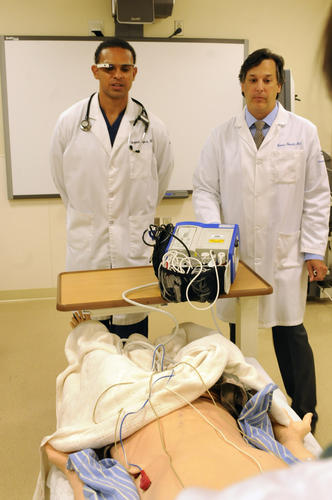Doctor Paul Bajwa, left, a resident at Hartford Hospital, uses Google Glass during a mock medical emergency at the hospital. At right, Doctor Thomas Nowicki, director of Cognitive Simulation at the hospital's Center for Education Simulation and Innovation, CESI, and the director of the residency program oversees the mock emergency.