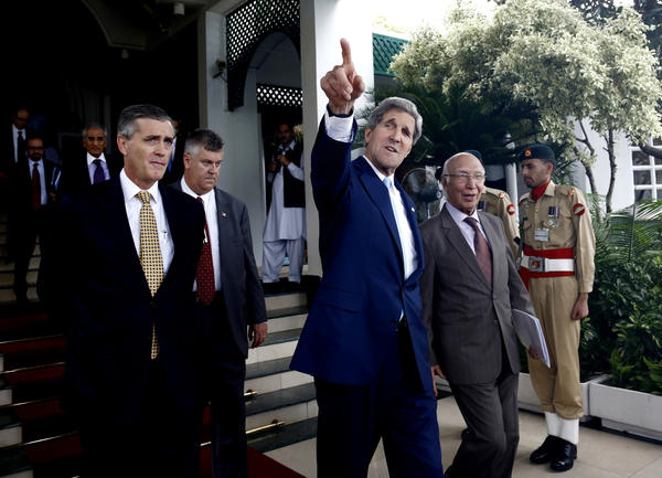 U.S. Secretary of State John F. Kerry leaves a press conference with his Pakistani counterpart Sartaj Aziz, right, in Islamabad, Pakistan.