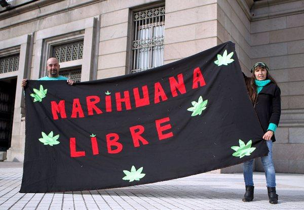 Demonstrators express support for legalizing marijuana outside Uruguay's Congress in Montevideo on Wednesday.