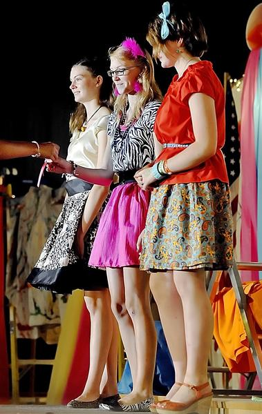 Jessie Hogbin, left, Jasmine Miller and Amanda Padrutt recieve red ribbons for their outfits at the 2012 Berkeley County Youth Fair style show. The 2013 Berkeley County Youth Fair opens Saturday, Aug. 3, at Berkeley County Fairgrounds in Martinsburg, W.Va.