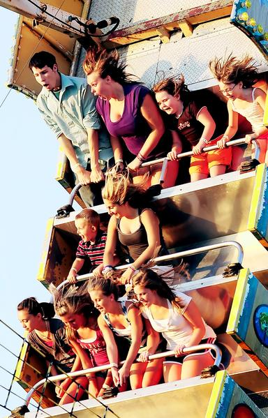 Devin Thomas, left, of Hagerstown and his friend Annie Bloyer, second from left, stand up on the Sea Ray ride at the Smithsburg Carnival in 2010.