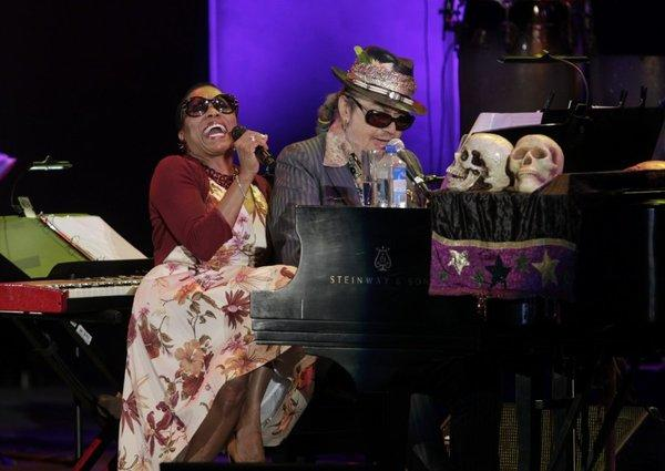 "Dr. John performs with Dee Dee Bridgewater on a playful ""Sweet Hunk of Trash"" during a concert honoring Louis Armstrong."