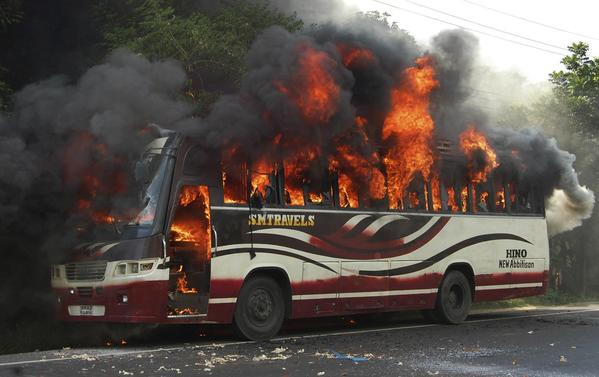 A bus in Bogra goes up in flames during protests by activists of Bangladesh's Jamaat-e-Islami after a court disqualified the party from taking part in the next general election.