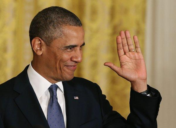 President Obama gestures to the audience before speaking about the Affordable Healthcare Act in the East Room of the White House on July 18, 2013.
