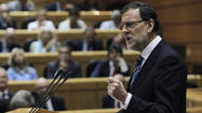 Spain's prime minister takes combative stand over corruption scandal