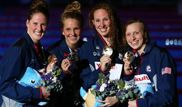 Gold rush: (L to R) Missy Franklin (4th gold of meet), Karlee Bispo, Shannon Vreeland and Katie Ledecky (3rd gold) with their awards from the 4 x 200 free relay at the World Championships in Barcelona.