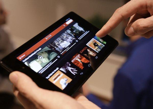 The Nexus 7 tablet is demonstrated during a new product introduction by Google at Dogpatch Studios in San Francisco. U.S. adults spend 63 minutes a day on tablet devices, according to a report by the research firm eMarketer.