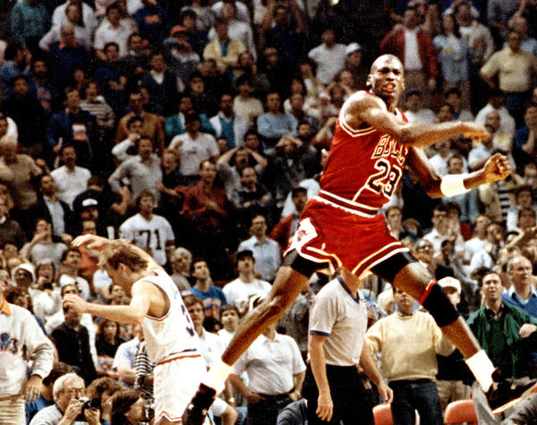 The Chicago Bulls' Michael Jordan reacts after hitting the game-winning basket over Cleveland's Craig Ehlo in Game 5 of the NBA playoffs May 7, 1989, in Cleveland.