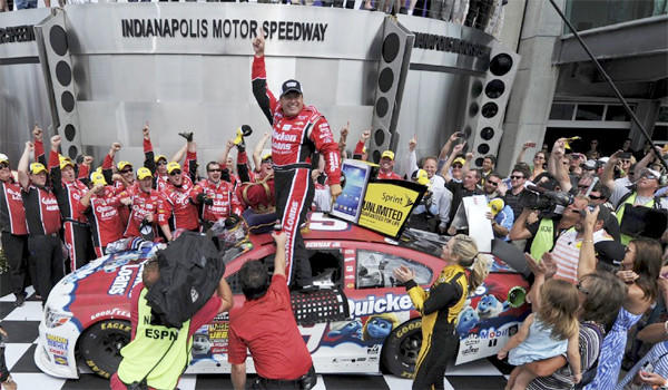 NASCAR Sprint Cup Series driver Ryan Newman celebrates after winning the Brickyard 400 auto race at the Indianapolis Motor Speedway on Sunday.