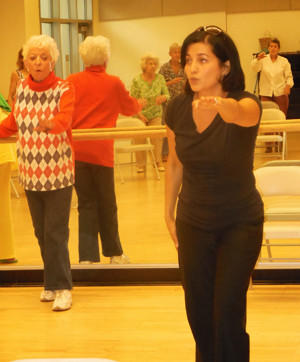 Geeta Singh teaches a class at Susi Q Senior Center where students like Lola Gillebaard can learn how to prevent falls.