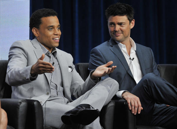 "Michael Ealy, left, and Karl Urban, stars of the upcoming Fox series ""Almost Human,"" take part in a panel discussion during the TCA press tour at the Beverly Hilton hotel in Beverly Hills."