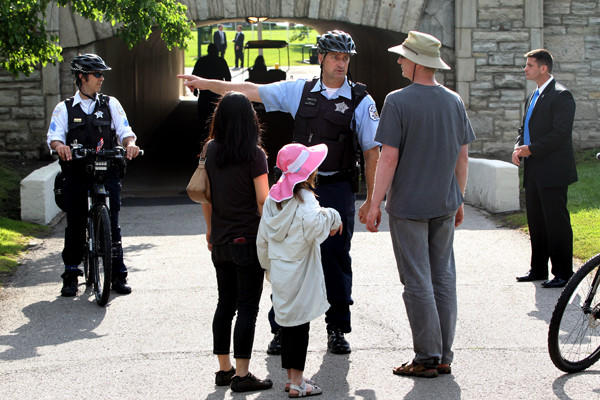 Matthias Blume, his wife Michiko Shimizu, and daughter Mayu Blume, 8, are redirected from a closed tunnel at Promontory Point prior to the wedding reception for George Lucas and Mellody Hobson.