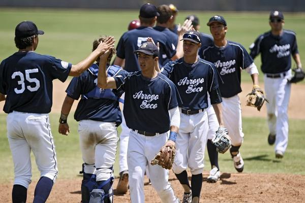 Arroyo Seco Saints players give each other high fives after needing only five innings to defeat Jakarta, Indonesia, 13-0, in the opening game of the Palomino World Series at the MLB Urban Youth Academy in Compton on Thursday. (Raul Roa/Staff Photographer)