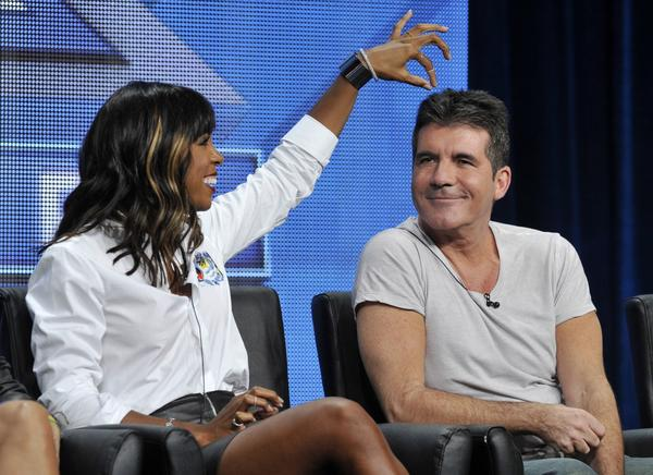 "Kelly Rowland, left, a new judge on Simon Cowell's ""The X Factor,"" jokes with Cowell during the TCA press tour at the Beverly Hilton hotel in Beverly Hills."