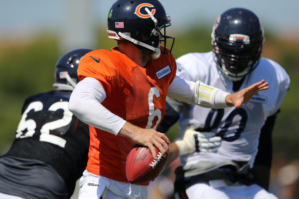 Bears' quarterback Jay Cutler looks to make a pass during training camp Thursday.