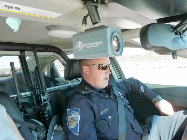 Nevada Highway Patrol troopers, including Nate Peterson, are writing more tickets on the road to Las Vegas, even for minor infractions, to fight the problem of speeding on Interstate 15.