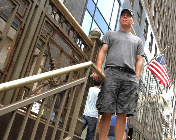 Gary Martin, of Ontario, Canada, stands at the spot where he tackled a purse-snatcher on Michigan Avenue.
