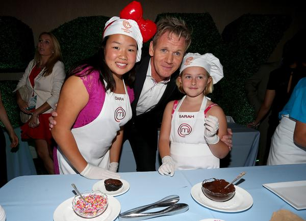 "Gordon Ramsay, the executive producer of ""Junior MasterChef,"" is joined by Dara, left, and Sarah, contestants on the show, at theTelevision Critics Assn. press tour in Beverly Hills."