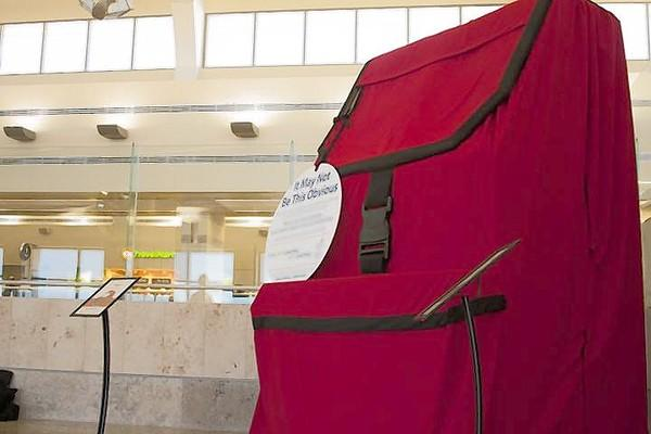 A 10-foot red backpack is part of the If You See Something, Say Something campaign in Orange County. Travelers who take their picture with it could win two Angels tickets.
