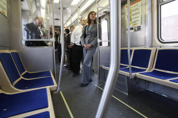 Board member Katie McClain, right, takes a ride with other CTA board members, employees and media Thursday, April 15, 2010 on one of the new 5000 series passenger rail cars being shown to the news media after a news conference.