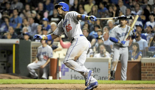 Yasiel Puig hits a home run (11) in the ninth inning of the Dodgers' 6-4 victory over the Chicago Cubs at Wrigley Field on Thursday.