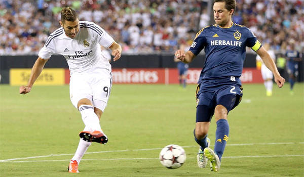 Karim Benzema scores one of his two goals in Real Madrid's 3-1 victory over the L.A. Galaxy in the International Champions Cup.