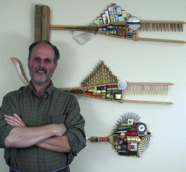 "Steve Palmer stands by some of the sculptural pieces in his ""School of Fish and Shiny Things"" exhibit opening Saturday, Aug. 3, at Three Pines Studio in Cross Village."