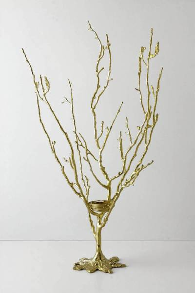 This jewelry tree from Anthropologie ($98) is pretty enough to be displayed as a design item on your dressing table or bathroom counter and can accommodate rings, necklaces, bracelets and earrings with hook-style backs.
