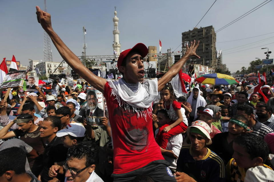 Supporters of deposed Egyptian President Mohamed Mursi shout slogans during a protest at the Rabaa Adawiya square where they are camping, in Cairo August 2, 2013.