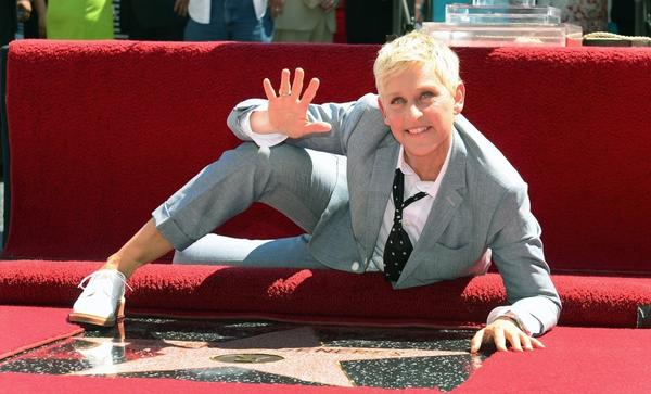 Ellen DeGeneres, posing with her Hollywood Walk of Fame star last year, will be returning to host the Academy Awards in 2014.