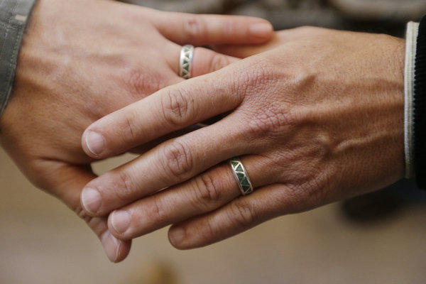 A gay couple show off their wedding rings after tying the knot in San Francisco. On Friday, the State Department said that those in same-sex marriages will be given the same preferential consideration in their visa applications now enjoyed by those in opposite-sex marriages.