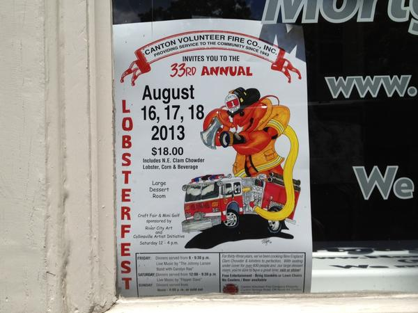 A poster in a store window in Collinsville promotes the Canton Volunteer Fire Department's upcoming Lobsterfest.