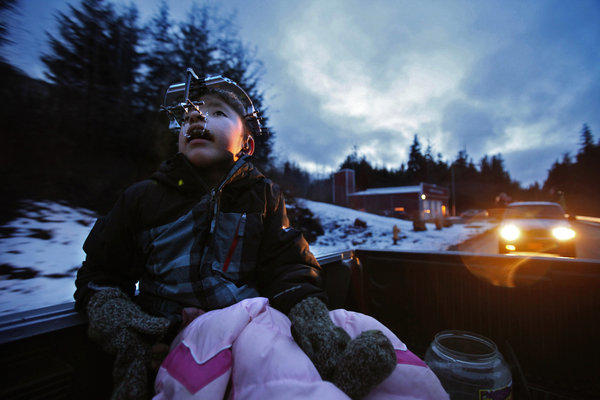 James Weatherwax, 11, rides in the back of his grandfather's truck. James was born with Apert syndrome, a rare genetic mutation that fuses the skull prematurely, distorts the bones of the face and melds the muscles and bones of the fingers and toes.