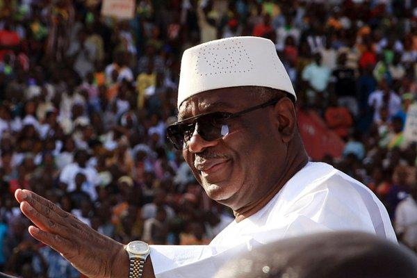 Mali's former prime minister, Ibrahim Boubacar Keita, waves to supporters at a stadium in Bamako Jan. 14, 2013. He will face former Finance Minister Soumaila Cisse in a presidential runoff Aug. 11.