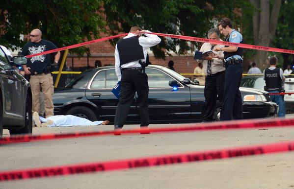 Chicago police investigate the scene where a 27-year-old man was shot to death in the Winneconna Parkway neighborhood.