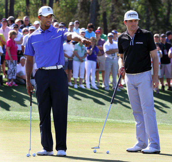 Tiger Woods (left) and Keegan Bradley during the Masters in April.