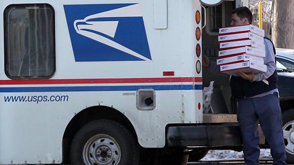 Mailman Joe Glenka unloads boxes outside the Elmhurst U.S. Post Office in February.