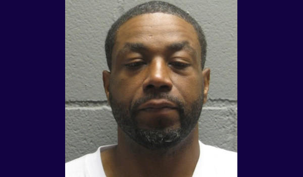 Michael Reid, 37, has been charged with murder in a 2010 slaying in Harvey, and is suspected in three others, according to a spokesman for Harvey police