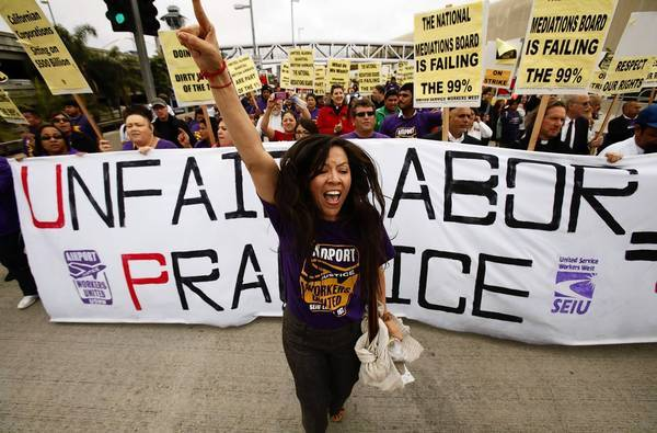 In California, 45,000 healthcare workers were recently wooed by the National Union of Healthcare Workers. They ultimately voted to stay with the Service Employees International Union. Above, Alejandra Valles, an SEIU vice president, leads protesters on a march in and near Los Angeles International Airport.
