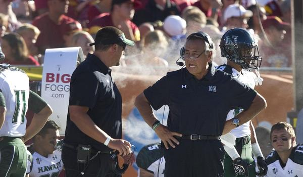 Hawaii football coach Norm Chow, center, has dismissed offensive coordinator Aaron Price.