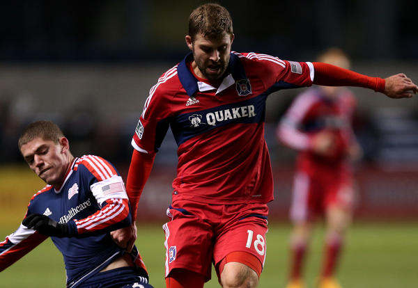 New England Revolution midfielder Donald Smith (left) and Chicago Fire player Steven Kinney battle for the ball in the first half at Toyota Park on March 9.
